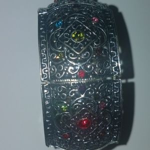 Thick silver bracelet with multiple color stones